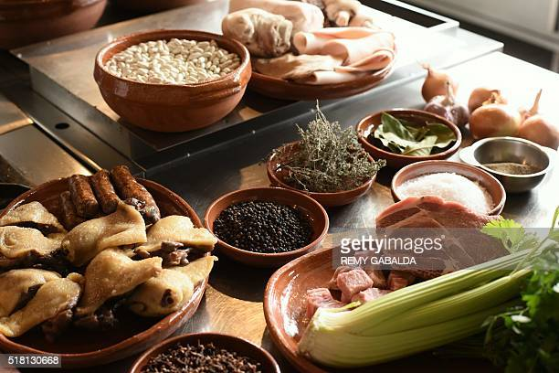 A photo taken on March 4 2016 shows ingredients of the cassoulet displayed in the kitchen of JeanClaude Rodriguez head chef of the Chateau Saint...