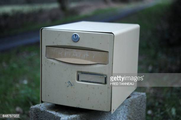 A photo taken on March 6 2017 in PontdeBuis western France shows the name 'Troadec' handwritten on a mailbox at the house of Lydie Troadec sister of...