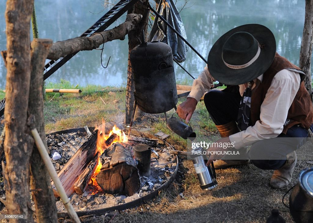FILE Photo taken on March 7 of a gaucho prepares 'mate' traditional herbal infusion during the Patria Gaucha festival on March 7 in Tacuarembo...
