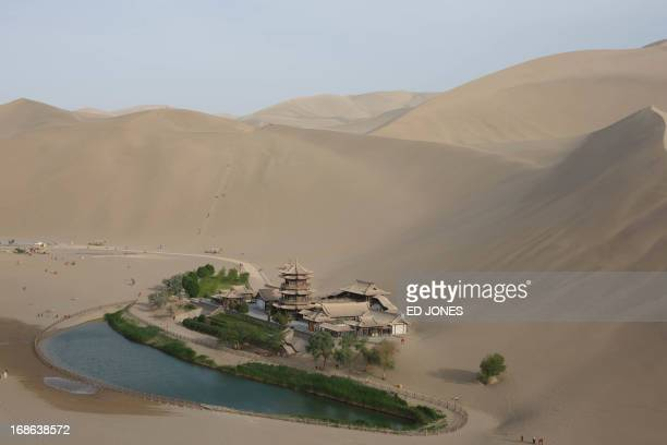 A photo taken on May 12 2013 shows a general view of the Yueyaquan Crescent Lake in Dunhuang in China's northwestern Gansu province Formerly a silk...