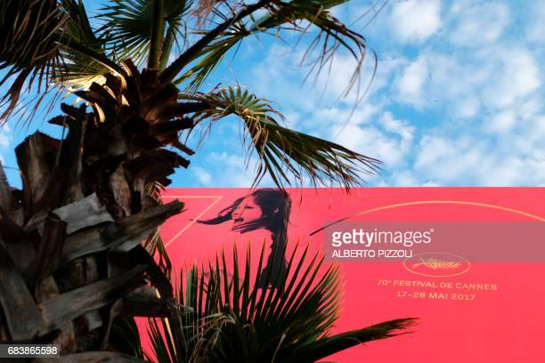 A photo taken on May 16 2017 shows the official poster on the eve of the opening ceremony of the 70th edition of the Cannes Film Festival in Cannes...