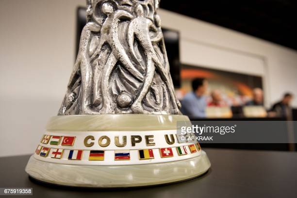 A photo taken on May 2 2017 shows Ajax's UEFA Europa League Cup from 1992 during the Ajax Amsterdam press conference in Amsterdam on the eve of their...