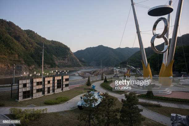 A photo taken on May 21 2017 shows a general view of art installations at the Peace dam north of Hwacheon near the Demilitarized Zone separating...