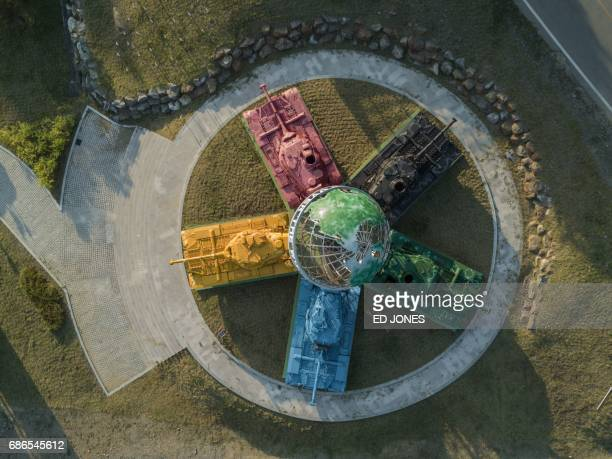 TOPSHOT A photo taken on May 21 2017 shows an aerial view of an art installation featuring Korean warera tanks painted in different colours around a...