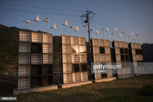 A photo taken on May 21 2017 shows an art installation featuring propaganda loudspeakers arranged to read 'Peace' at the Peace dam north of Hwacheon...