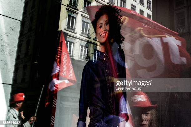 A photo taken on May 22 2017 in Lyon shows employees of French department store Tati demonstrating in front of a Tati store Five companies submitted...
