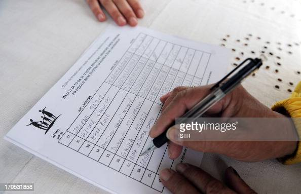 Photo taken on May 23 in Zagreb shows a Croatian citizen signing a petition calling for a referendum to introduce a constitutional clause describing...