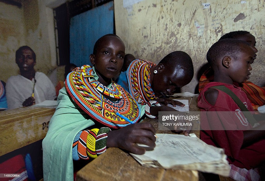 Photo taken on May 24 2012 shows young Samburu children attending evening lessons in solarlit classrooms at Loltulelei primary school a volunteer...