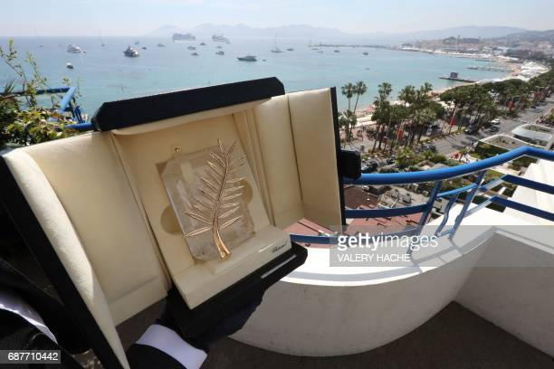 TOPSHOT A photo taken on May 24 2017 at the Grand Hyatt Cannes Hotel Martinez in Cannes southern France shows the Palme d'Or trophy inlaid with...