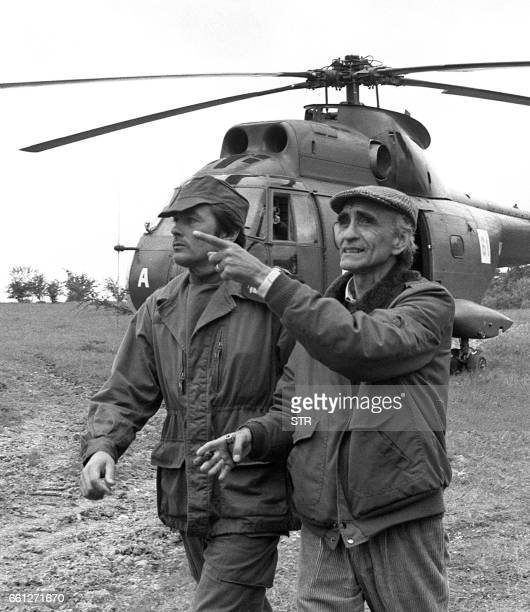 File picture taken 26 May 1979 of late French movie director Pierre GranierDeferre talking to French actor Alain Delon during the shooting of the 'Le...