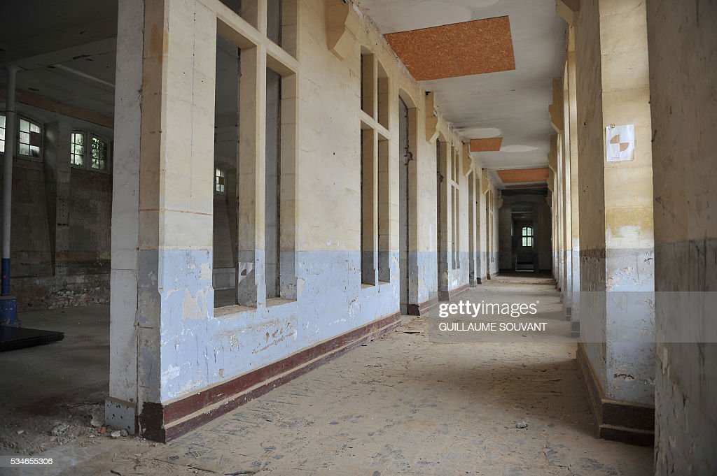 A photo taken on May 27, 2016 shows an interior view of the site of the future courthouse of Poitiers, western France. The future courthouse bring together the Court of Appeal, the High Court, the District Court, the Labour Court and the Commercial Court. This is the rehabilitation and extension of the Jesuit High School 'Feuillants'. / AFP / GUILLAUME