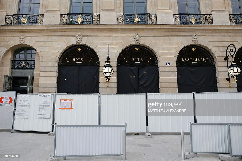 A photo taken on May 27, 2016 shows the facade of the Hotel Ritz on the Place Vendome in Paris, under renovation. / AFP / MATTHIEU