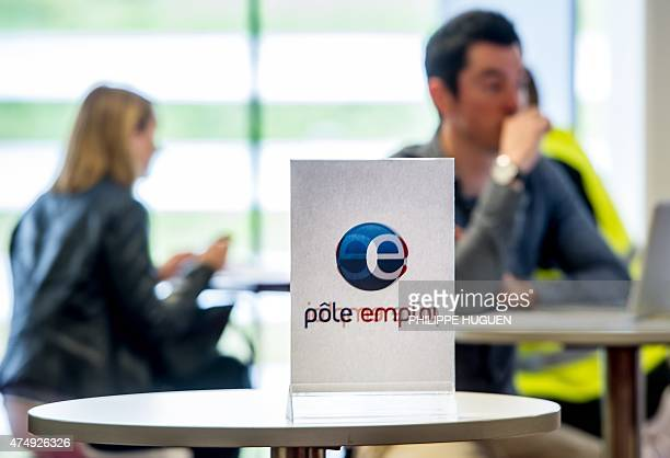 A photo taken on May 28 2015 in Lille shows a man visiting the stand of French Pole Emploi employment agency at a employment fair in Lille AFP PHOTO...