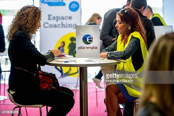 A photo taken on May 28 2015 in Lille shows a woman visiting the stand of French Pole Emploi employment agency at a employment fair in Lille AFP...