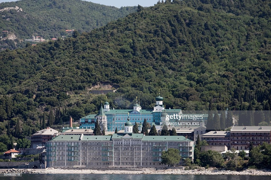A photo taken on May 28, 2016 shows the Russian St. Panteleimon Monastery, in Mount Athos on 28 May, 2016 where the President of the Russian Federation Vladimir Putin will visit. Russian President is visiting Mount Athos in Greece to mark the 1,000-year presence of Russian Orthodox monks there. Russian President Vladimir Putin signed several economic deals with Athens on on May 27, 2016 during a visit to Greece aimed at reinforcing a relationship with one of his few friends in the EU amid tensions with the West. MITROLIDIS