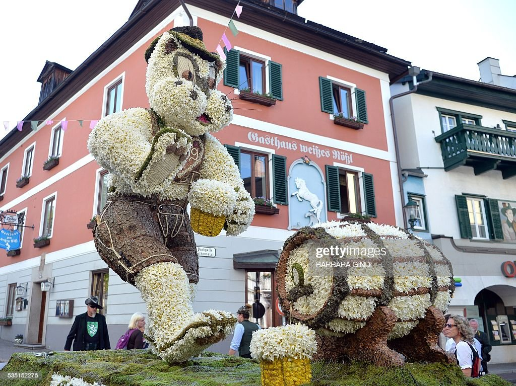 A photo taken on May 29, 2016 shows a rabbit with Austrian traditional cloth and a beer made of Daffodil in a parade during the 57th Daffodil Festival in Bad Aussee. / AFP / APA / BARBARA GINDL / Austria OUT