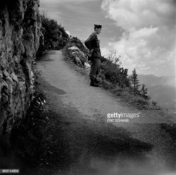 Photo taken on May 4 1945 shows a US soldier on the way to the Berghof Adolf Hitler's home in the Obersalzberg of the Bavarian Alps near...