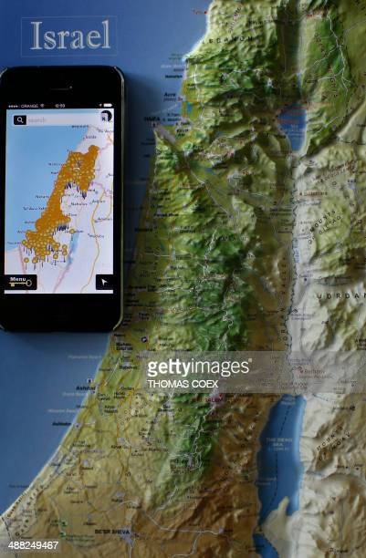 A photo taken on May 5 2014 shows a smartphone placed on an Israeli map in Jerusalem displaying the new application developed by Israeli...