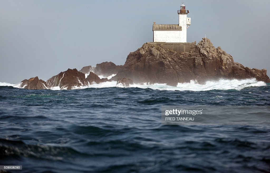 A photo taken on May 5, 2016 shows the lighthouse of Tevennec, northwestern France, where President of the National Society for heritage lighthouses and beacons (SNPB) Marc Pointud passed two months alone to alert on the emergency of the restauration of those historical buildings. / AFP / FRED