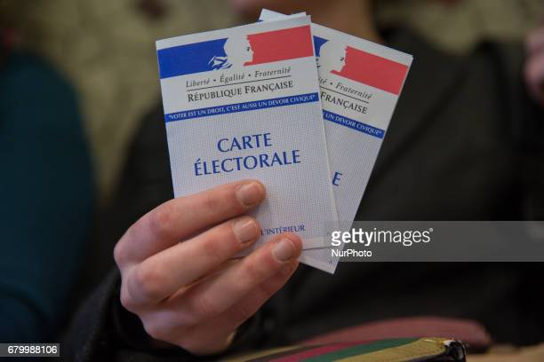 A photo taken on May 7 2017 in Paris France shows a electoral card For the second round of the French Presidential elections Frenhc citizens have the...