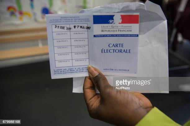 A photo taken on May 7 2017 in Paris France shows the date of the second round of the French presidential election stamped on a electoral card For...