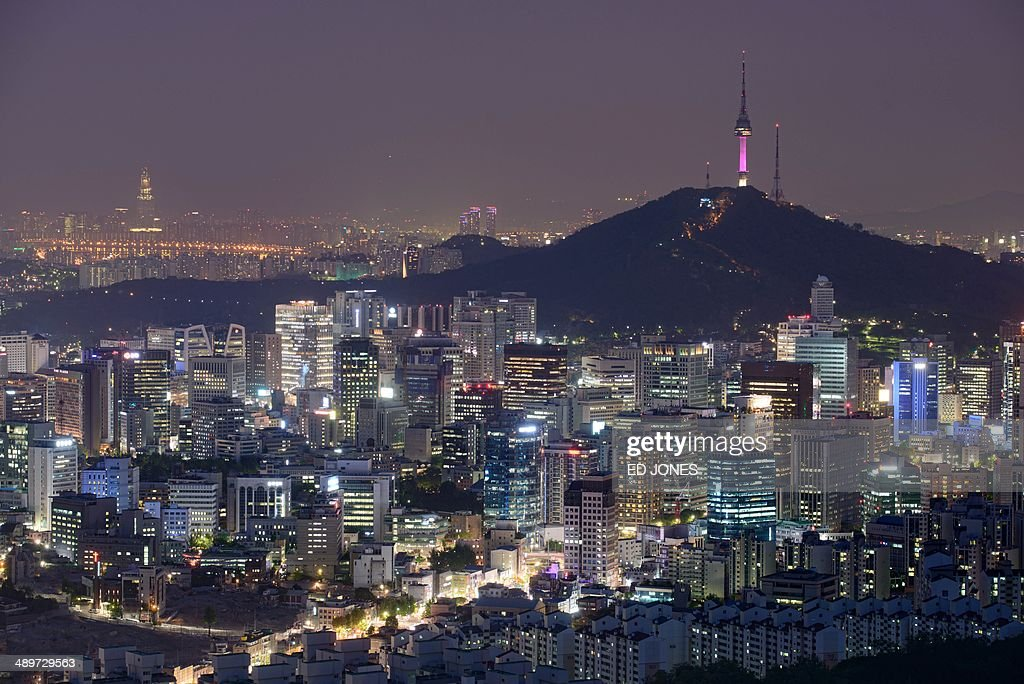 A photo taken on May 9 2014 shows a general view of the Seoul city skyline at dusk The global cost of securing a clean energy future is rising by the...