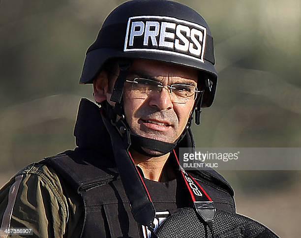 Photo taken on November 11 2012 shows Turkish photojournalist Bunyamin Aygun working at Ceylanpinar in Urfa near the Syrian border Turkish...