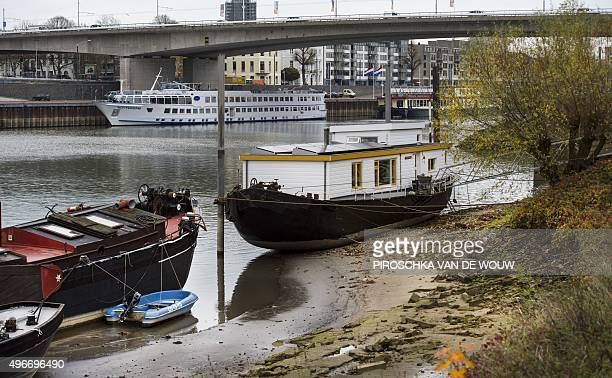 A photo taken on November 11 2015 shows houseboats laying dry in Arnhem after the water level lowered as never before in the Rhine in almost 40 years...