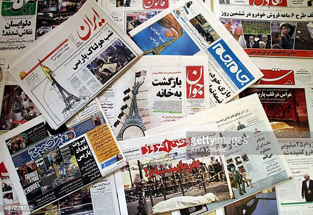 A photo taken on November 15 2015 in the Iranian capital Tehran shows newspapers bearing the headlines of the deadly Paris attack that left more than...