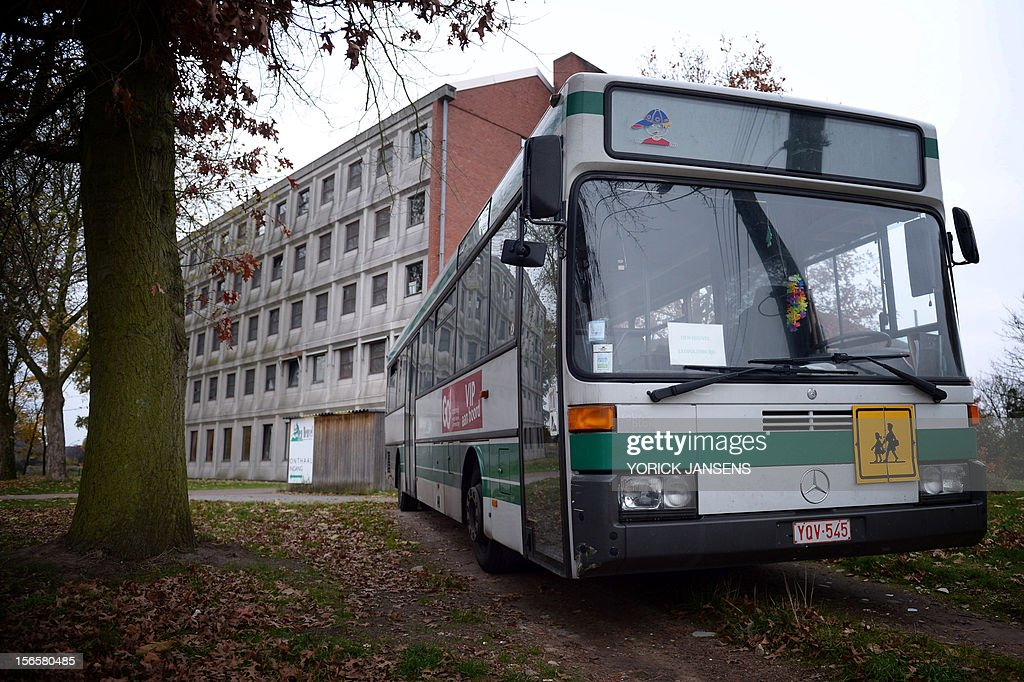 Photo taken on November 17, 2012 shows a school bus parked outside the Den Heuvel boarding school in Leopoldsburg. A Belgian newspaper reported on November 17 that multiple cases of sexual abuse between pupils of different ages were carried out in the center. AFP PHOTO / BELGA / YORICK JANSENS -- BEGIUM OUT --