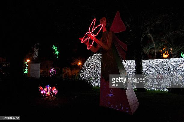 Photo taken on November 17 2012 shows Christmas lights illuminating the streets of downtown Salerno southern Italy part of an exhibition called...
