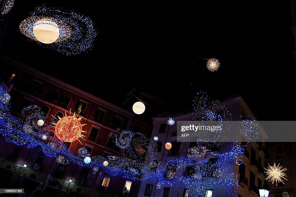 Photo taken on November 17, 2012 shows Christmas lights illuminating the streets of downtown Salerno, southern Italy, part of an exhibition called 'Artist' lights' created by several Italian artists. AFP PHOTO/ KATIA DI RUOCCO