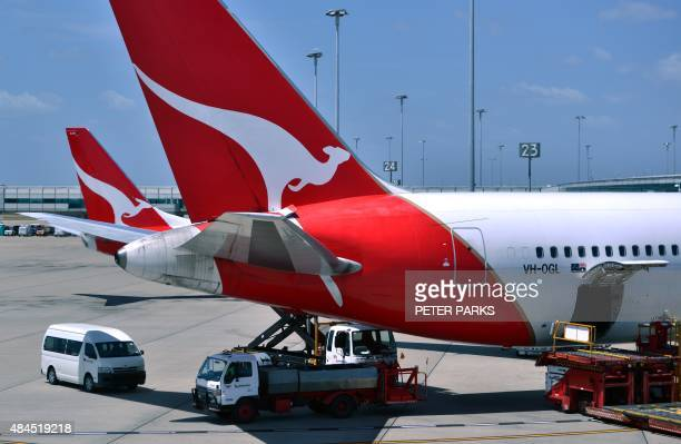 Photo taken on November 17 2014 shows Qantas planes at Sydney Airport Australian carrier Qantas on August 20 2015 roared back into the black in a...