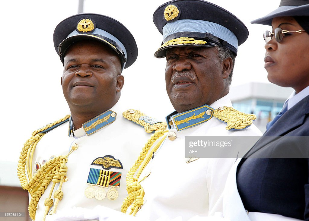 A photo taken on November 2, 2012 shows Zambian President <a gi-track='captionPersonalityLinkClicked' href=/galleries/search?phrase=Michael+Sata&family=editorial&specificpeople=1944545 ng-click='$event.stopPropagation()'>Michael Sata</a> (C) and Zambia Air Force commander Eric Chimese (L) attending the graduating cadet officers parade in Livingstone. Sata on November 30, 2012 told the military to 'deal' with a separatist movement in the nation's Western Province. Sata said a group of mainly ethnic Lozi had recruited around 630 fighters into its ranks, after declaring plans to create a state called Barotseland in March. AFP Photo / Joseph Mwenda