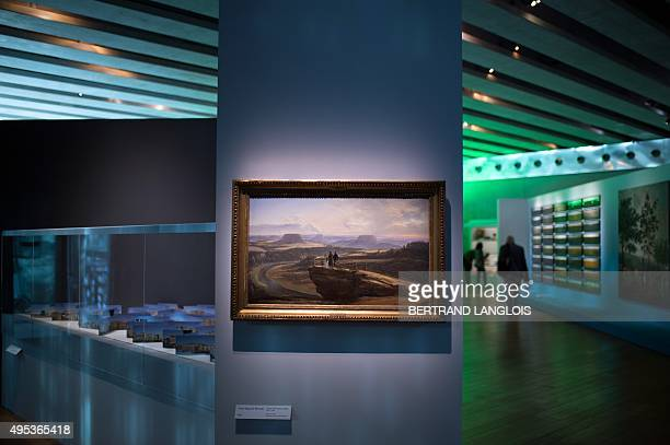A photo taken on November 2 2015 shows the painting 'Vue depuis Bastei' by Norwegian artist Johan Christian Dahl as part of the exhibition 'J'aime...