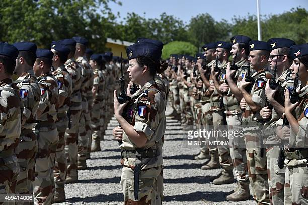 A photo taken on November 22 2014 shows soldiers of the '28 Regiment transmission' standing at attention as the French Prime Minister and French...