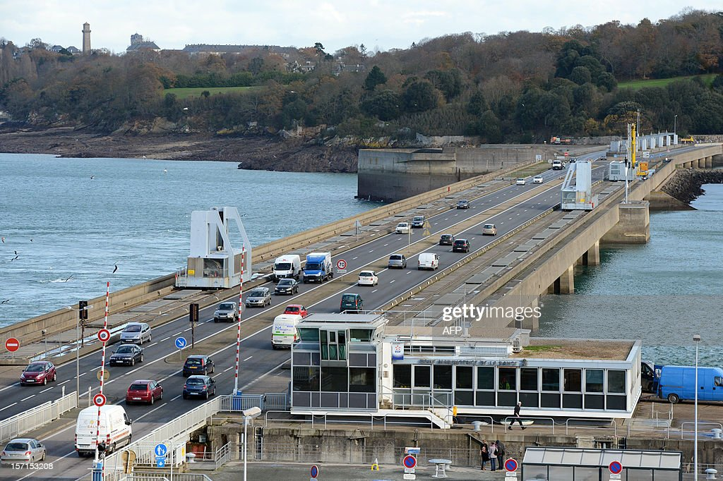 A photo taken on November 28, 2012 shows cars on a bridge that is the external part of the La Rance tidal-turbine power plant in La Richardais, western France.