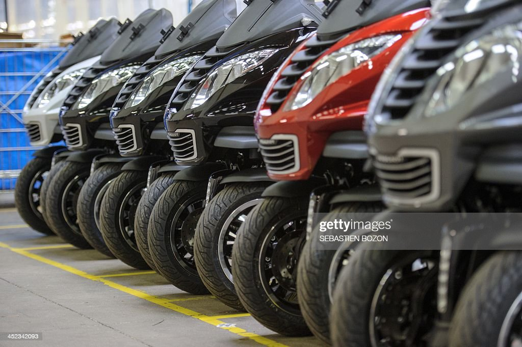 Photo taken on November 28, 2013 shows Peugeot Metropolis motorcycles parked in a at the factory of the French car and motorcycle maker PSA Peugeot Citroen in Mandeure, eastern France.