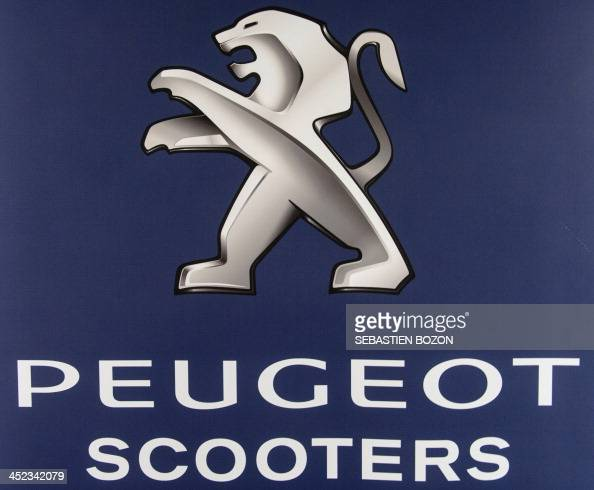 Photo taken on November 28 2013 shows the logo of Peugeot motorcycles at the Peugeot factory in Mandeure eastern France AFP PHOTO / SEBASTIEN BOZON
