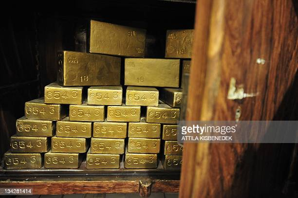 A photo taken on November 29 2011 shows gold ingots in an antique safe about 100 years old shown at the 'History of Money' exhibition at the...