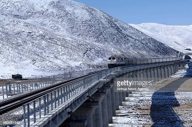 Photo taken on Oct 25 2006 shows a train running on the plateau in southwest China's Tibet Autonomous Region People witnessed amazing progress of the...