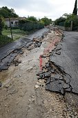 A photo taken on October 11 2014 shows a road in the Pradet neighborhood in the southern French town of SainteAnastasie following torrential rain...