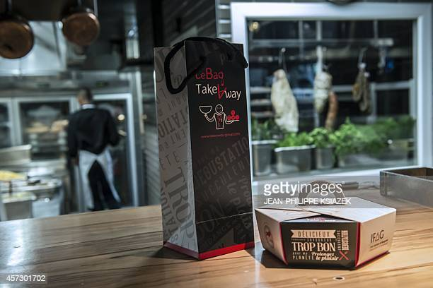 A photo taken on October 16 2014 shows 'doggy bags' in the kitchen of a restaurant in Lyon central eastern France The Food Agriculture and Forestry...