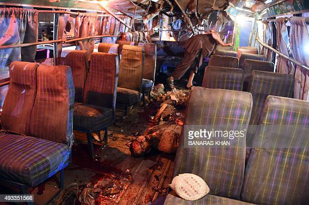 A photo taken on October 19 2015 shows the body of a blast victim lying in a bus after a bomb explosion in Quetta At least 10 people were killed and...