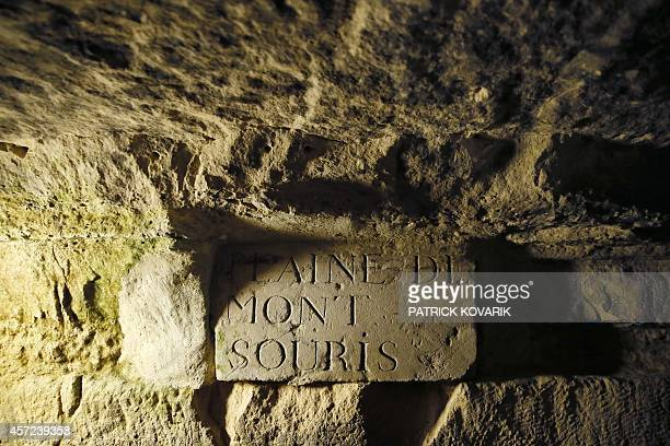 A photo taken on October 2014 at the Paris catacombs of Paris shows a view of the quarries The underground quarries were used to store the remains of...