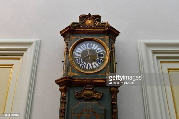 A photo taken on October 21 2016 shows a clock in the Pontiff's private apartments now open to tourists as a museum at the former summer residence in...