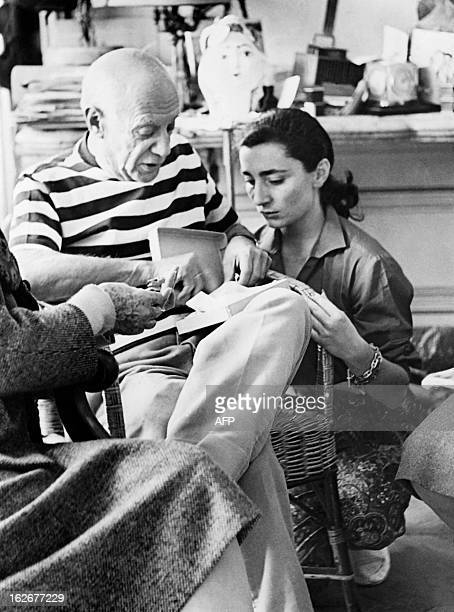 A photo taken on October 22 1961 shows Spanish painter Pablo Picasso and his wife Jacqueline sharing a private moment in their house in Vallauris AFP...