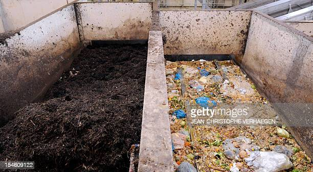 A photo taken on October 23 2012 in Morsbach western France shows compost and waste food products stocked at the Methavalor factory to produce...