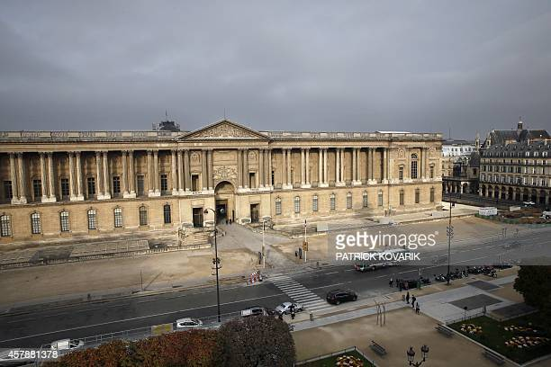 A photo taken on October 26 2014 from the roof of the SaintGermain l'Auxerrois church shows the Louvre museum in Paris AFP PHOTO / PATRICK KOVARIK