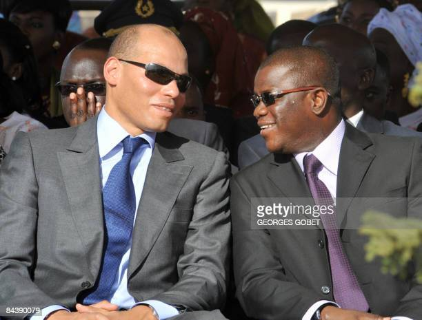 A photo taken on October 30 2008 shows the son of Senegalese President Abdoulaye Wade Karim Wade speaking with the generalsecretary of the Senegalese...